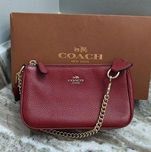 Coach-Nolita purse in black cherry.